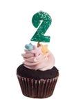 Mini cupcake met verjaardagskaars voor twee éénjarigen Royalty-vrije Stock Foto