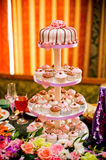Mini cupcakes on a multi level tier. Pink and brown Stock Photo