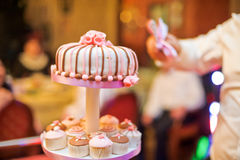 Mini cupcakes on a multi level tier. Pink and brown Stock Images