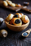 Mini curd and poppy seeds pies. Small pies with curd and poppy seeds topping stock photo