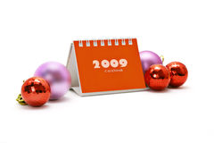 Mini desktop calendar and Christmas ornaments Stock Photos