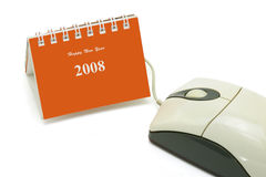 Mini desktop calendar and computer mouse stock photos