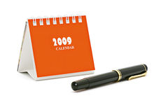 Mini desktop calendar and fountain pen royalty free stock photos