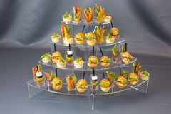 Mini desserts and meat canapes vegetable snacks Stock Image