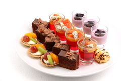 Mini desserts on white Royalty Free Stock Photos