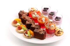 Mini desserts on white Royalty Free Stock Photos