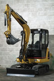 Mini digger. Parked in the mechanic garage Stock Images