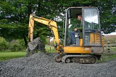 Mini digger. Small digger moving sub base royalty free stock photo