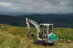 Mini Digger in the Mountains Royalty Free Stock Images
