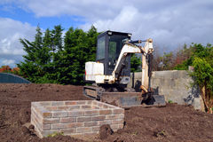 Mini digger. Small mini digger on a residential building site royalty free stock image