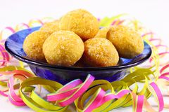 Mini doughnuts in a blue bowl with streamers Royalty Free Stock Images