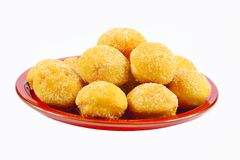 Mini donuts on a red plate Royalty Free Stock Image