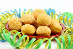 Mini doughnuts on a red plate with streamers Stock Image