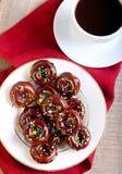 Mini- donuts som täckas med choklad Fotografering för Bildbyråer