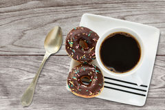 Mini doughnut with chocolate and sprinkles cup of coffee breakfast Royalty Free Stock Image