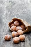 Mini  doughnuts in paper bag on rustic  wooden table Royalty Free Stock Photos
