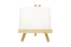 Mini drewniana sztaluga z pustą kanwy ramą odizolowywającą zdjęcia stock