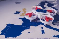 Mini drone flying over a EU map. European rules for drone aerial aircraft law concept. Mini drone flying over a EU map. The EU is working on a regulation to Stock Image