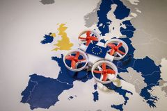 Mini drone flying over a EU map. European rules for drone aerial aircraft law concept. Mini drone flying over a EU map. The EU is working on a regulation to Stock Photography