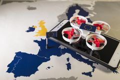 Mini drone flying over a EU map. European rules for drone aerial aircraft law concept. Mini drone flying over a EU map. The EU is working on a regulation to Royalty Free Stock Photography