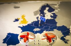 Mini drone flying over a EU map. European rules for drone aerial aircraft law concept. Mini drone flying over a EU map. The EU is working on a regulation to Royalty Free Stock Image