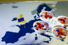 Mini drone flying over a EU map. European rules for drone aerial aircraft law concept. Mini drone flying over a EU map. The EU is working on a regulation to Stock Photos
