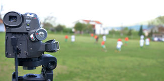 Mini dv camera recording soccer match Stock Images