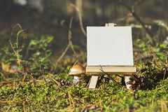 Mini Easel On Seasonal Forest Background. Stock Photos