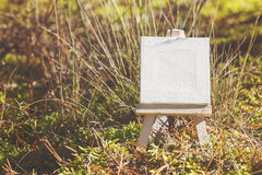 Mini Easel On Seasonal Forest Background. Royalty Free Stock Photos