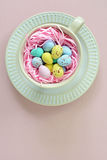 Mini Easter eggs in cup in vertical format Stock Image