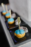 Mini Eclair Glazed with Blue Color Sugar served with Sweet Crush Taro and Black Sesame Stock Image