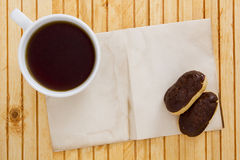 Mini Eclairs with a cup Royalty Free Stock Image