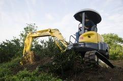 Mini-escavatore Immagine Stock