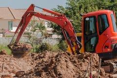 Mini escavatore a cucchiaia rovescia Fotografia Stock Libera da Diritti