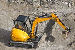Mini excavator. High angle view of yellow mini excavator royalty free stock images