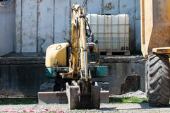 Mini excavator close up on industrial park royalty free stock photography