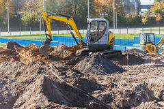Mini excavator on a construction site Stock Photos