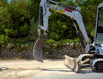 Mini excavator dig a trench Stock Photos