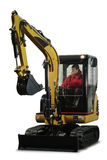 Mini excavator with driver. A little excavator with the driver inside looking up Stock Photos