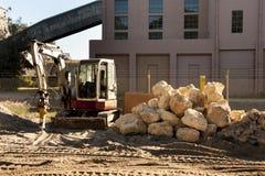 Mini Excavator. On Construction Site stock image
