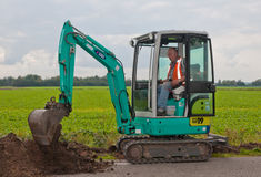 Mini excavator is moving soil Royalty Free Stock Photos
