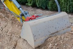 Mini excavator for road works for internet and power supply stock image
