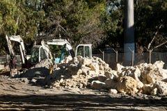 Mini Excavators. On Construction Site royalty free stock photo