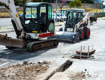 Mini excavators used for implementation of the new network. Infrastructure of optical fibers Stock Photography