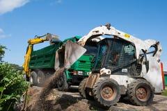 Mini excavatrice au chantier de construction Image stock