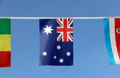 Mini fabric rail flag of Australia in blue red and white color with white star and Union Jack hanging on the rope cloth. stock image