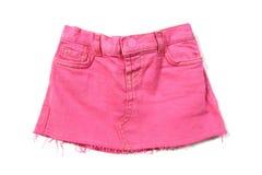 Mini falda rosada de los pantalones vaqueros Foto de archivo
