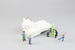 Mini figure with battery charge Royalty Free Stock Photo
