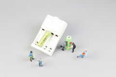 Mini figure with battery charge. The Mini figure with battery charge at the site Stock Image