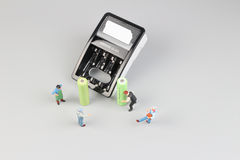 Mini figure with battery charge. The Mini figure with battery charge at the site Royalty Free Stock Image